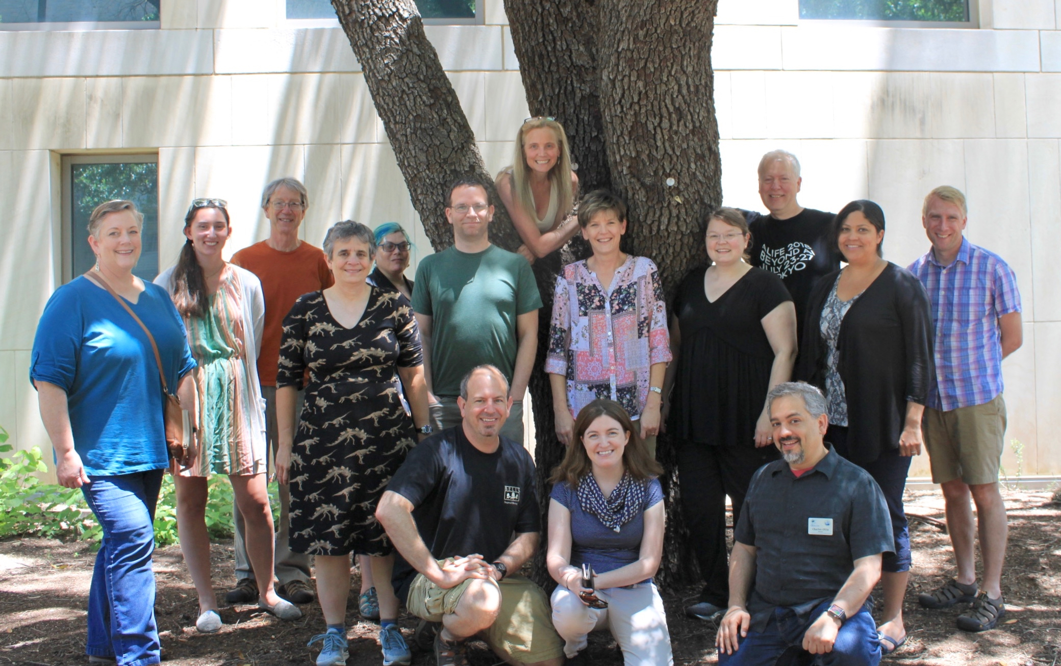 group of participants and instructors under oak tree at UT Austin